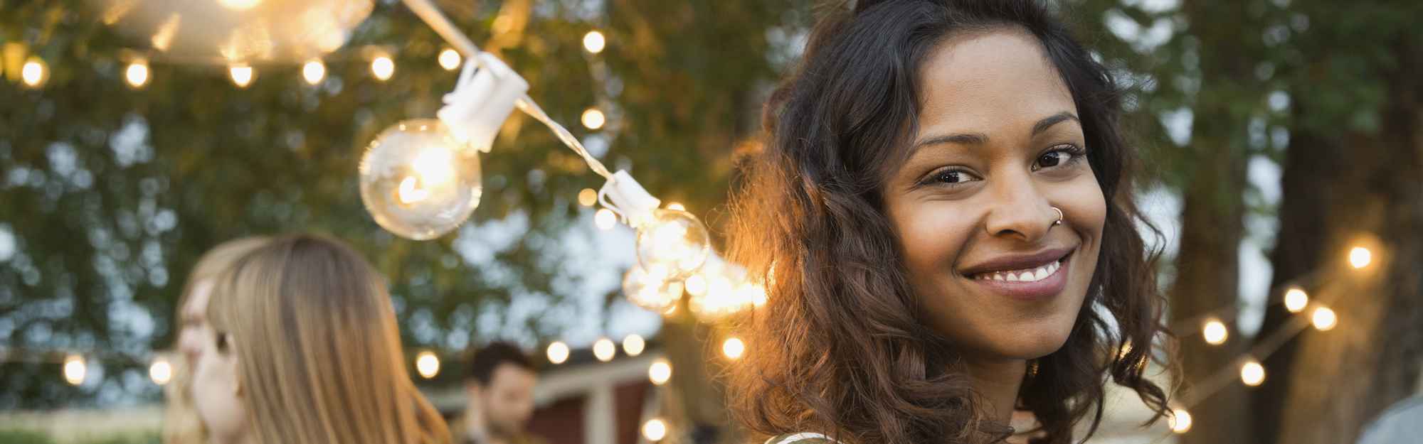 Smiling woman at an outdoor party